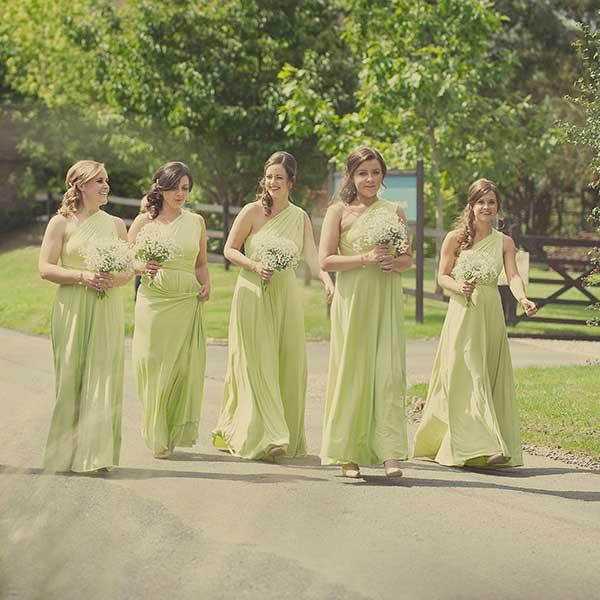 Bridesmaids walking down the driveway at Curradine Barns